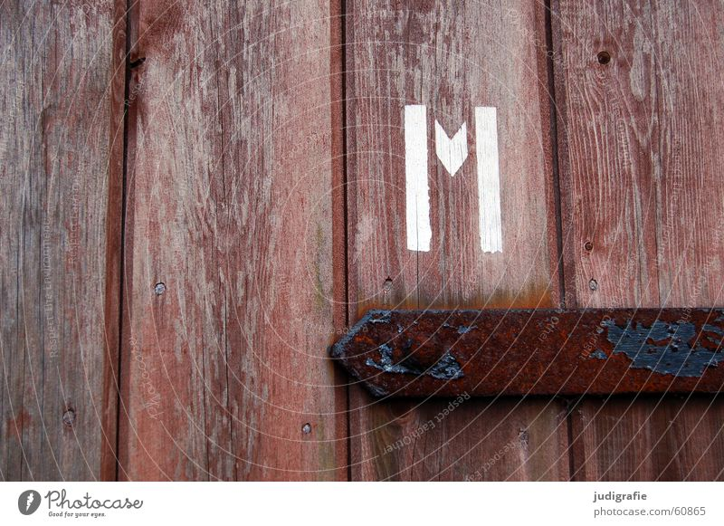 m Letters (alphabet) Typography Stencil letters Wood Wooden door Metal fitting Brown Man Gentleman Screw White Detail Colour Characters emm Door Rust Toilet