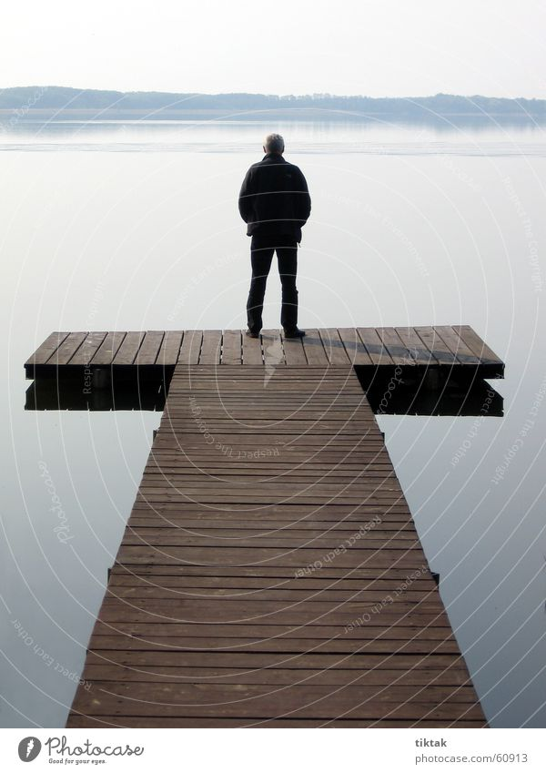 Man on T Footbridge Lake Wood Morning Calm Water Wooden board tomorrow at the lake Dawn Am Mellensee man by the water Relaxation