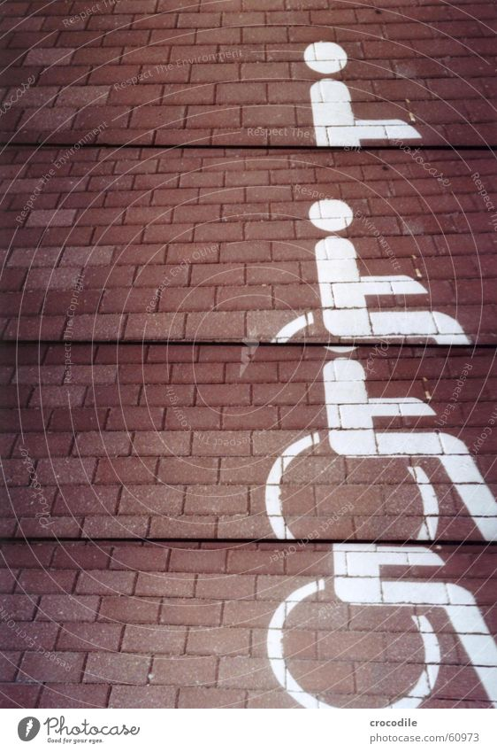 wheelchair parking Wheelchair Handicapped Unfair Red White Painted Lomography Disdvantaged Street Colour Paving stone
