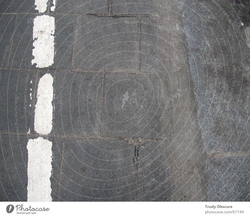 white stripes vs. grey street White Gray Subsoil Stone slab Symbols and metaphors Platform Station Wayside Border Floor covering Colour Signage Train station