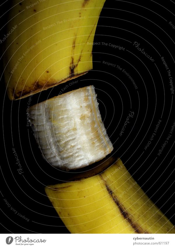 rotten and tummy free Banana Spoiled Brown Yellow Fruit Section of image Banana skin Cut Divided Division Part Detail Colour photo Brownish Dark background