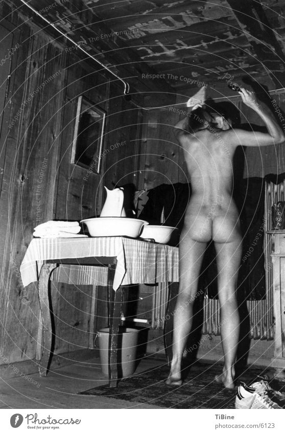 Woman Nude photography Beautiful Feminine Naked Back Young woman Bottom Thin Hut Personal hygiene Black & white photo House (Residential Structure) Hairbrush