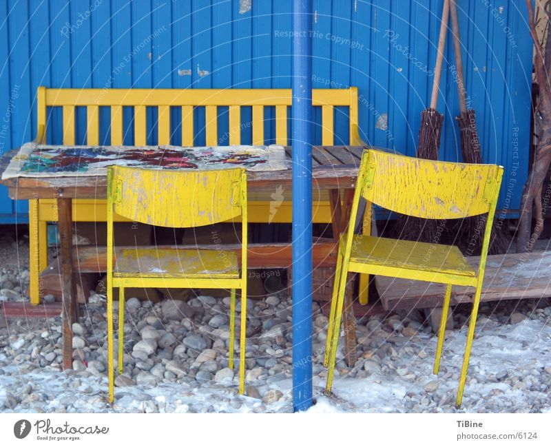 Still life in blue and yellow 2 Table Chair Yellow Site trailer Still Life Living or residing Blue Bench Exterior shot