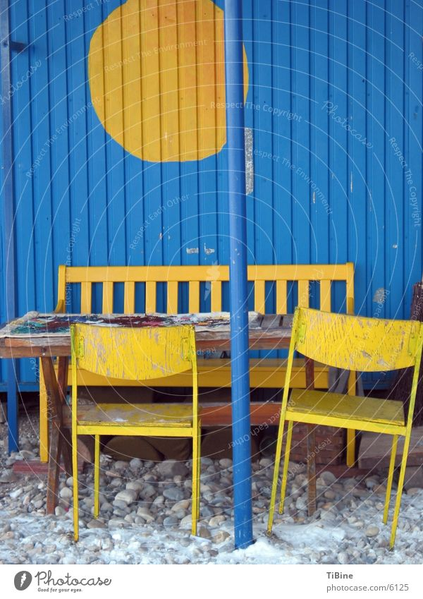 Still life in blue and yellow Table Chair Yellow Site trailer Still Life Living or residing Bench Blue Exterior shot