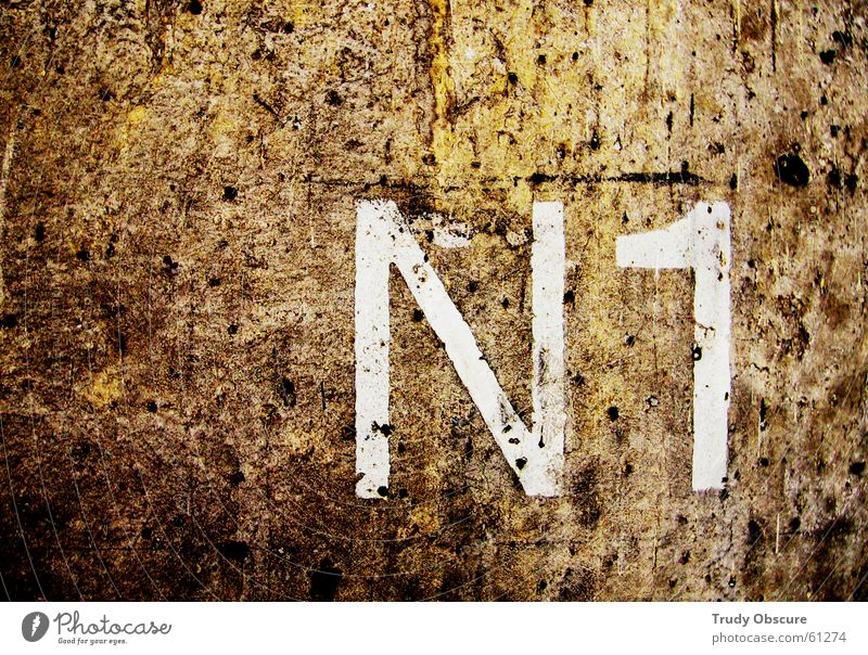 White Dark Wall (building) Wall (barrier) Brown Background picture Concrete Characters Digits and numbers Letters (alphabet) Surface