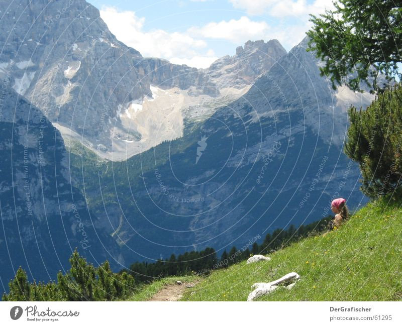 Heidi? Alpine pasture Meadow Mountain meadow Hiking Break Headscarf Wanderlust Far-off places Calm Panorama (View) Tourism Woman Loneliness Stone Massive Slope