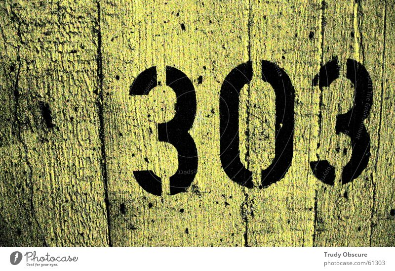 postcard no. 303 Background picture Wall (building) Wall (barrier) Surface Concrete Digits and numbers Yellow Black Parking garage Parking lot back wall Amount