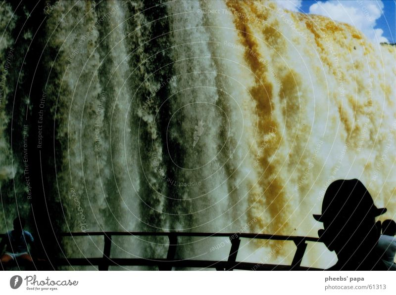Iguazú Electricity Silhouette Might Clouds Water Waterfall River Iguazu Falls paraguay Hat Human being Shadow Handrail Bridge Large Sky Blue