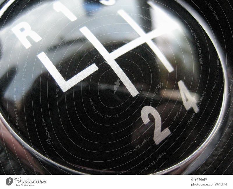 White Black 1 Car Line 2 3 Digits and numbers 4 Motor vehicle 5 Backwards Cudgel Gear shift Knob
