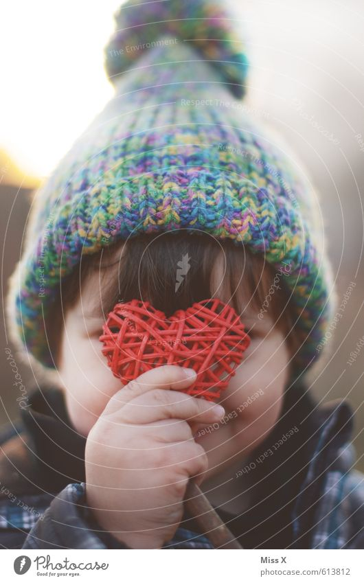 Human being Child Girl Love Boy (child) Infancy Decoration Smiling Heart Cute Cap Hide Infatuation Toddler Timidity Sympathy