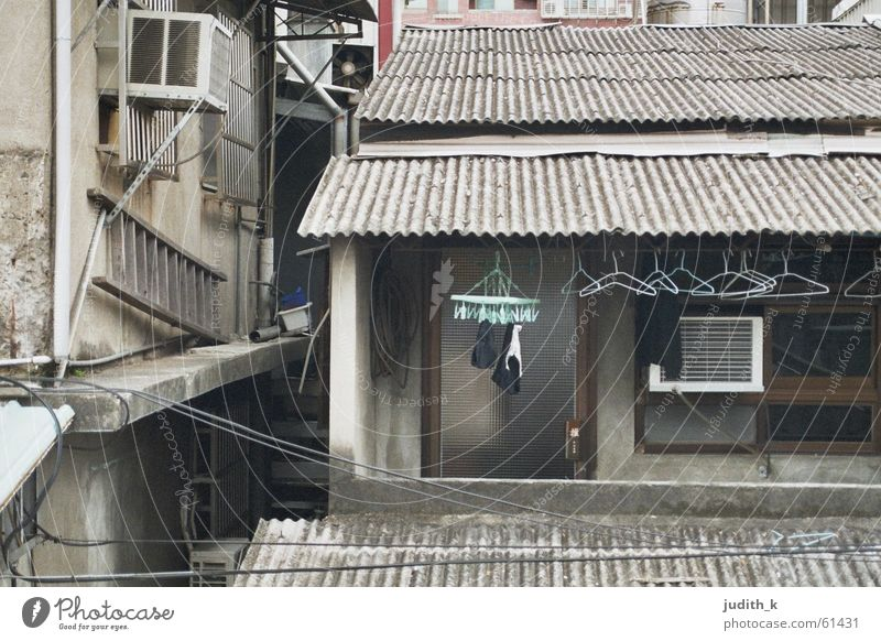 made in taiwan House (Residential Structure) Building Housing area Balcony Laundry Hanger Gray Turquoise Roof Corrugated sheet iron Window Harmful