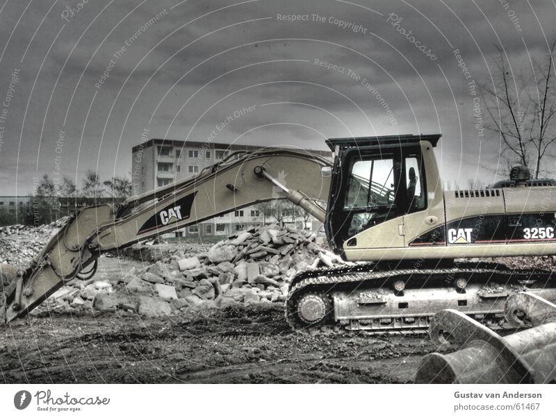 Socialist dismantling Clouds Dark Excavator Multicoloured Building rubble Heap Block Grief Exterior shot Dynamic compression Destruction GDR Poverty trieste