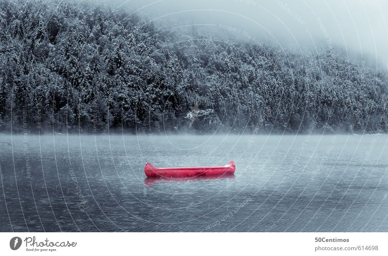 Red canoe in a wintry lake Vacation & Travel Tourism Trip Adventure Freedom Winter Mountain Sports Aquatics Winter sports Environment Nature Landscape