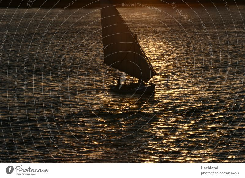 Evening at the Nile Egypt Dusk Sunset Waves Reflection Watercraft Dream Transcendence Ferryman River Sail sails in the light felluke rich in dead