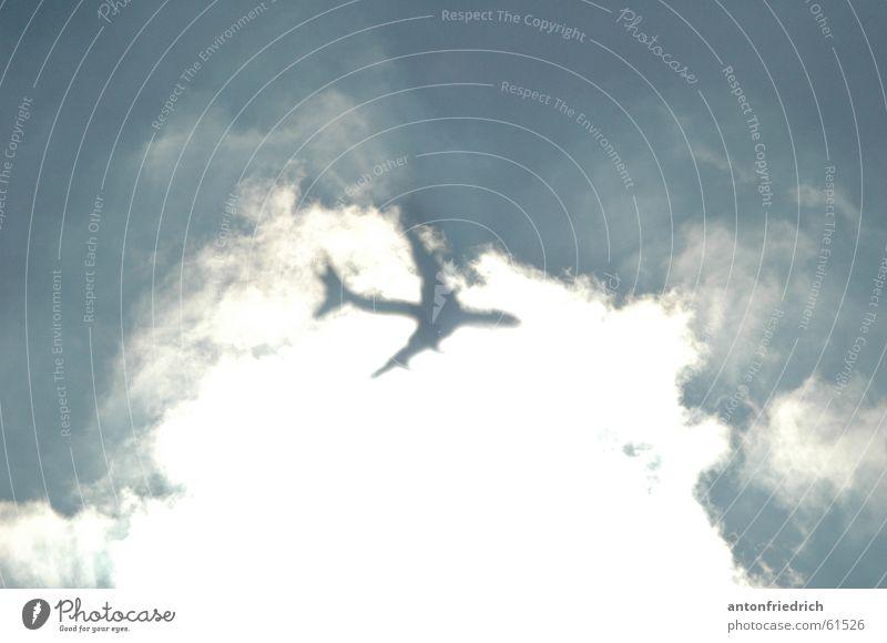 behind the curtain Clouds Vail Airplane Blur Shadow