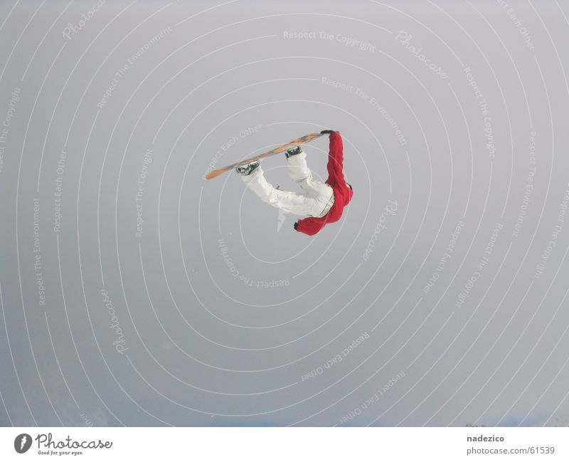 diedamspark Exterior shot Snowboarder airstyle rider fly red high fun Style in front of the sky