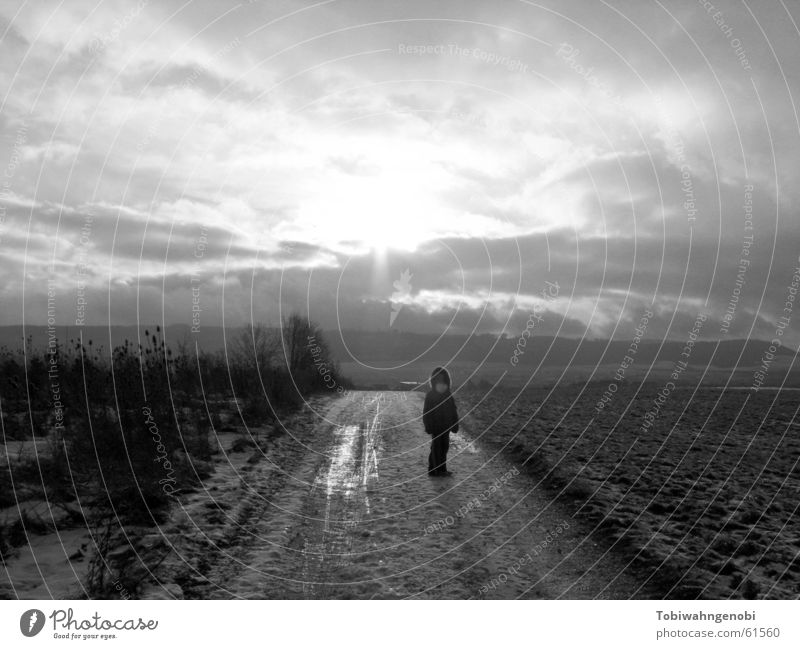 stroll Winter Child Clouds Field Black & white photo Snow Sun Sky