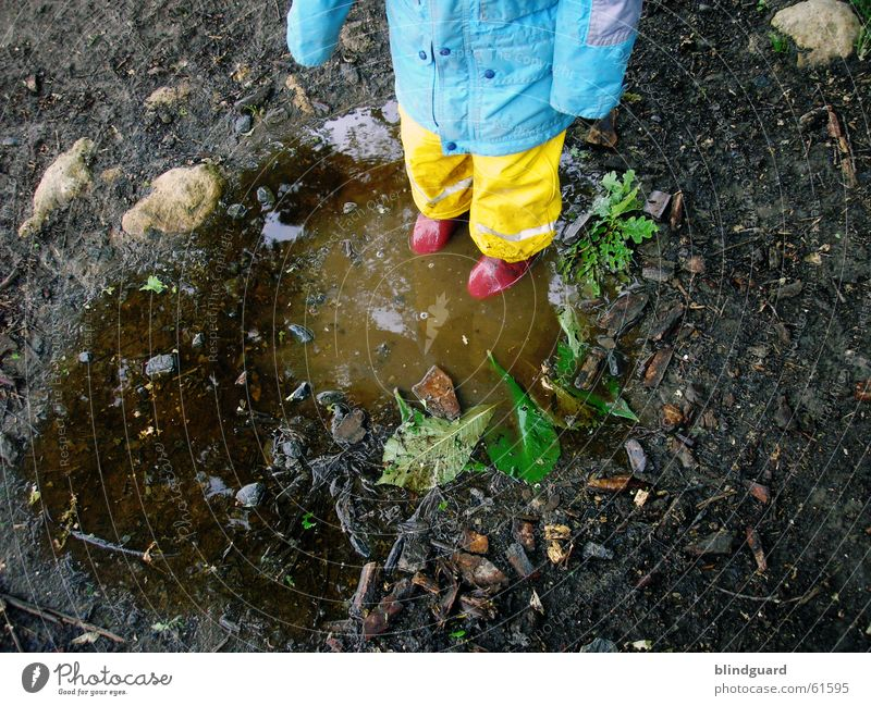 Child Joy Rain Dirty Wet Thunder and lightning Puddle Mud Rubber boots Bad weather Rain jacket Rain wear Rain suit