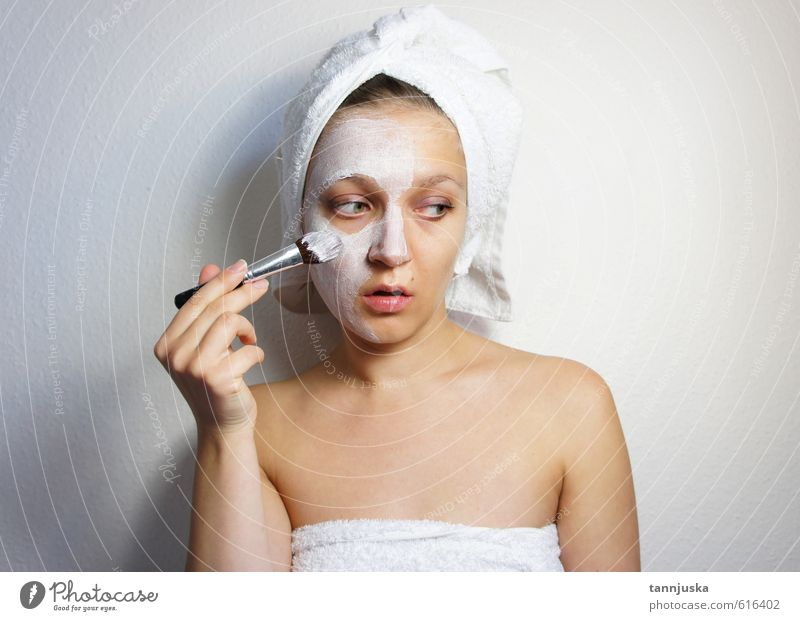 Young beautiful woman applying mask on her face Human being Woman Youth (Young adults) Beautiful White Hand Relaxation Girl Joy 18 - 30 years Face Adults Eyes