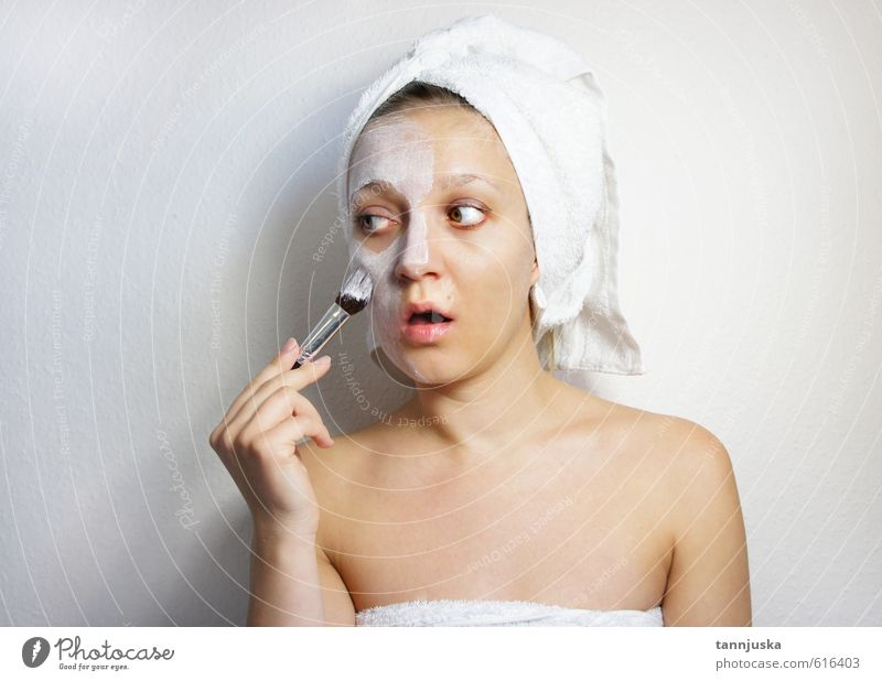 Young happy and beautiful woman applying clay facial mask Human being Woman Beautiful White Hand Relaxation Girl Joy Face Adults Emotions Funny Happy Natural