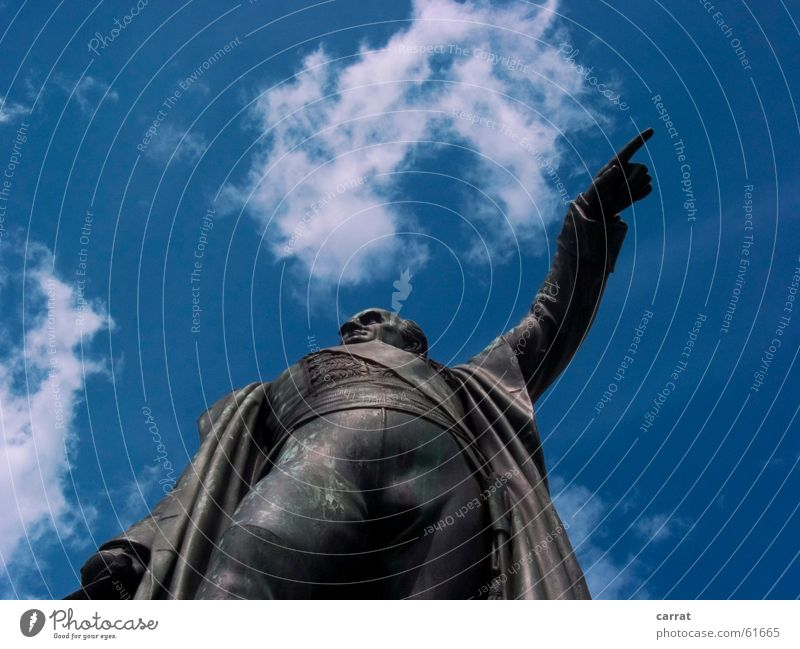 Show me the way... Statue Clouds Human being Indicate Blue Sky Signage Lanes & trails Road marking indicator that way it was him Where's the wind coming from?