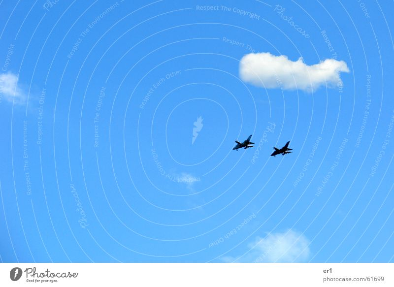 fighter jet Clouds Attack Airplane Speed War Destruction Grief Exterior shot Jet Sky Flying Blue in front of a blue background