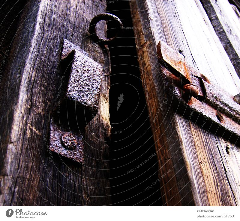 fissure Locking bar Dark Closed Mysterious Creepy Key Gardening equipment Rake Spade Watering can Castle Barn Rust Door Column Open Frightening