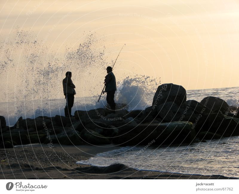 stand or go fishing Relaxation Fishing (Angle) Beach Ocean Waves Man 2 Human being Rock Coast Mediterranean sea Stand Authentic Free Agreed Interest Horizon