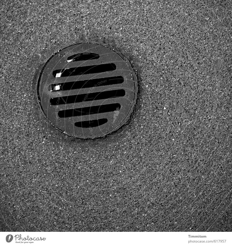 Mysterious Black Hole. Hollow Pipe Opening Grating Metal Wait Esthetic Dark Silver Precision Firm Stability Asphalt Black hole Black & white photo Exterior shot