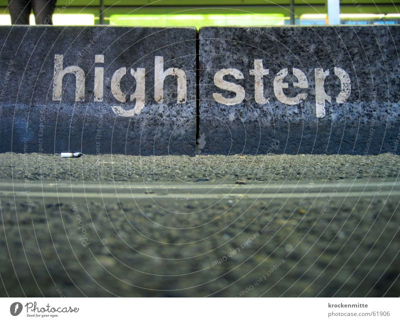 Asphalt Station Typography Stride Task Curbside Landing Stencil letters Cigarette Butt