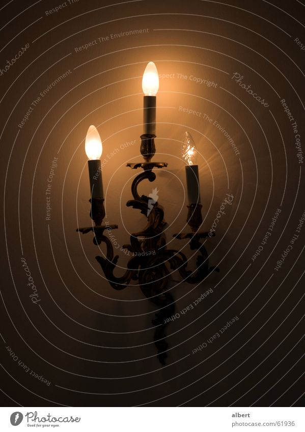 electric candles Candle Candle holder Lamp Electric bulb Dark Yellow Wall light