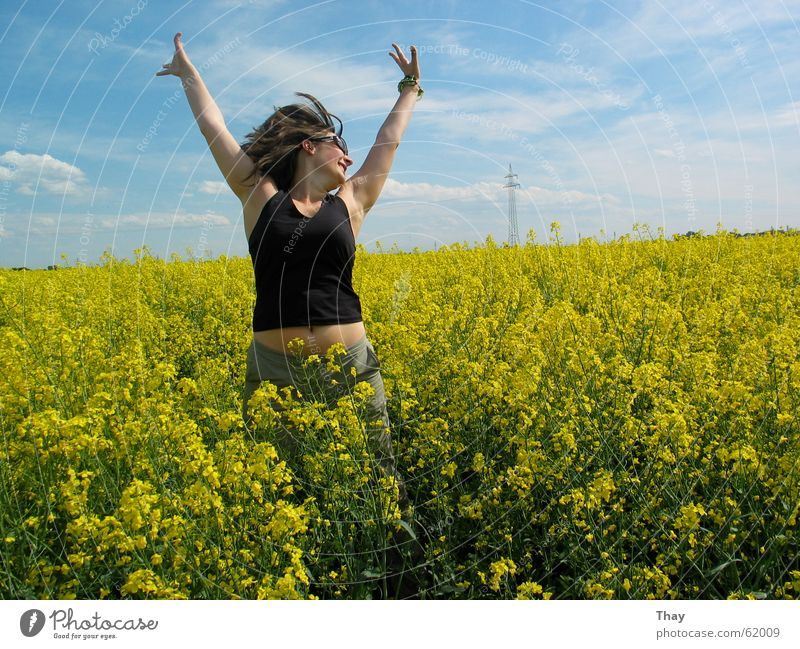 jump to heaven Jump Woman Canola Field Yellow Meadow Flower Summer Exterior shot Joy Happy