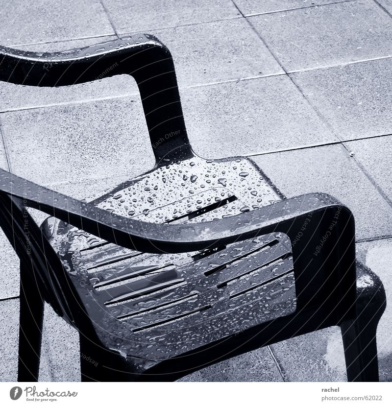 Cold Sadness Rain Weather Going Sit Wet Concrete Drops of water Living or residing Floor covering Chair Plastic Vantage point Gastronomy Sidewalk