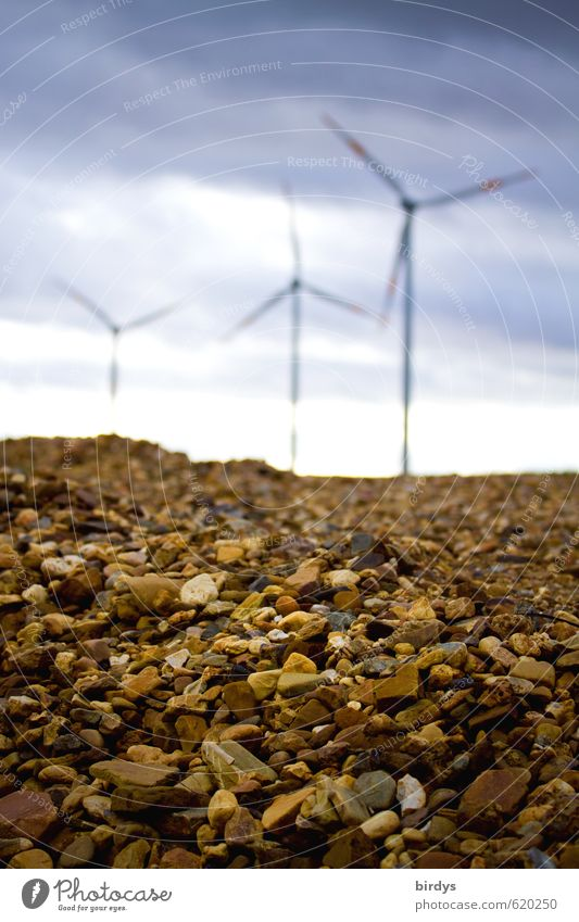 Is it all about gravel? Energy industry Renewable energy Wind energy plant Sky Clouds Rotate Esthetic Tall Positive Movement Sustainability Perspective