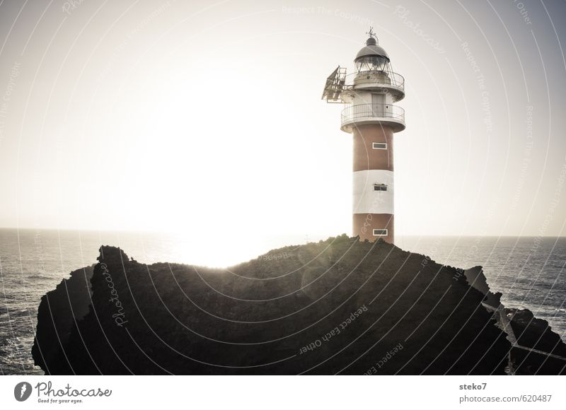 outpost Cloudless sky Beautiful weather Rock Coast Ocean Lighthouse Red White Safety Wanderlust End Horizon Far-off places Tenerife Groundbreaking Orientation