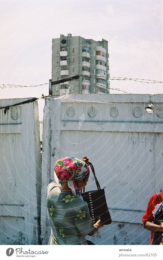 Headscarf in Osch Barbed wire Wall (barrier) Fence High-rise Woman Bag Lift Town Closed Kyrgyzstan Oppressive Enclosed Soviet Union