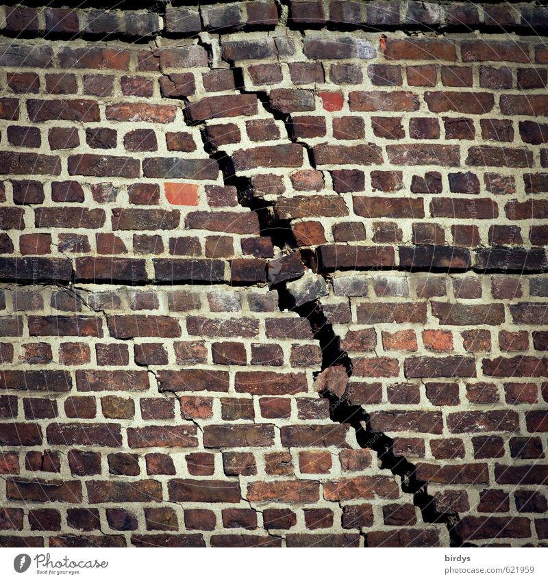 The crack Wall (barrier) Brick wall Crack & Rip & Tear Old Exceptional Threat Broken Senior citizen Esthetic Town Transience Destruction Tension