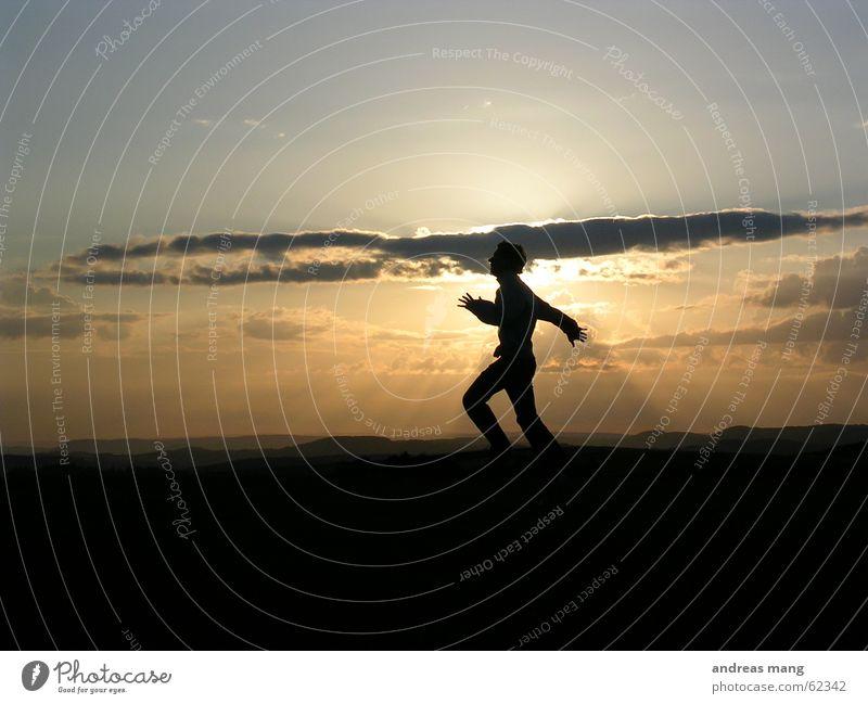 Human being Man Hand Sky Sun Joy Clouds Jump Mountain Freedom Landscape Lighting Horizon Dusk