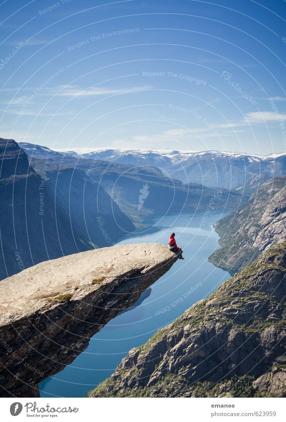 Man sitting on the Trolltunga in Norway Joy Calm Vacation & Travel Tourism Adventure Far-off places Freedom Summer Mountain Hiking Climbing Mountaineering