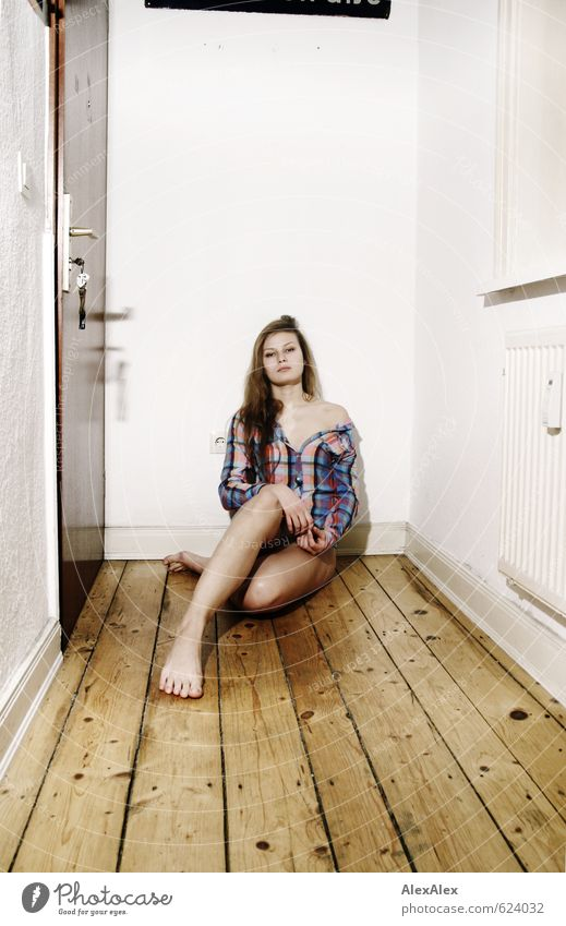 Wait a minute! Room Hallway Wooden floor Young woman Youth (Young adults) Legs Feet Shoulder 18 - 30 years Adults Shirt Barefoot Blonde Long-haired Crouch Sit