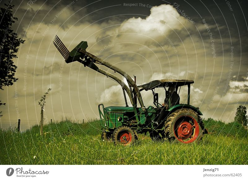 Country star. Tractor Agricultural machine Field Driving Machinery Meadow Clouds Work and employment Toys Farmer Pasture Sky