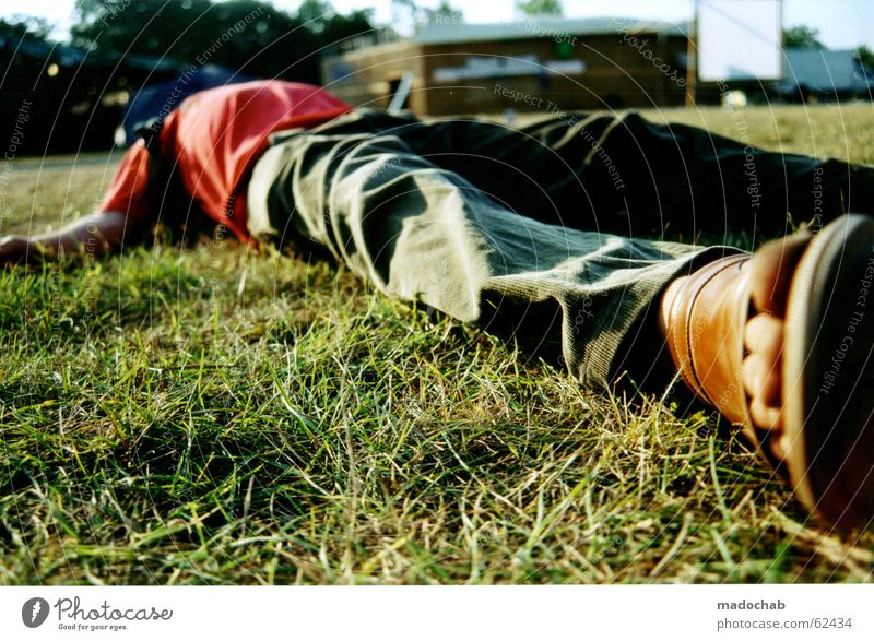 Man lying unconscious or asleep in a meadow during a festival - Alcohol consumption Intoxicant Impaired consciousness Drunken Doomed Emotions Jubilee Sleep