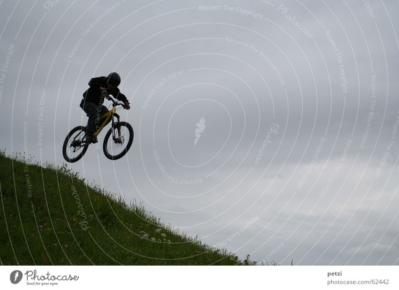 More beautiful than flying... Joy Freedom Bicycle Air Sky Clouds Bad weather Wind Meadow Helmet Flying Jump Speed Brave Concentrate Mountain bike Slope Steep