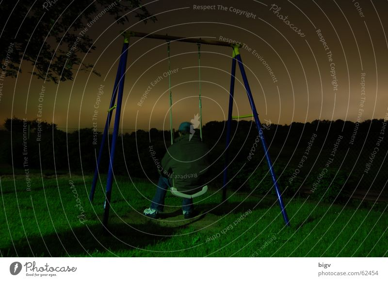 It's colder at night than outside Night Playground Swing Freeze Gray Calm Long exposure Sit