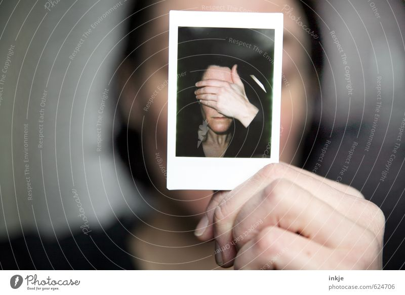 Woman holding Polaroid with woman with hand in front of face Lifestyle Style Feminine Adults Face Hand 2 Human being 30 - 45 years Photography To hold on