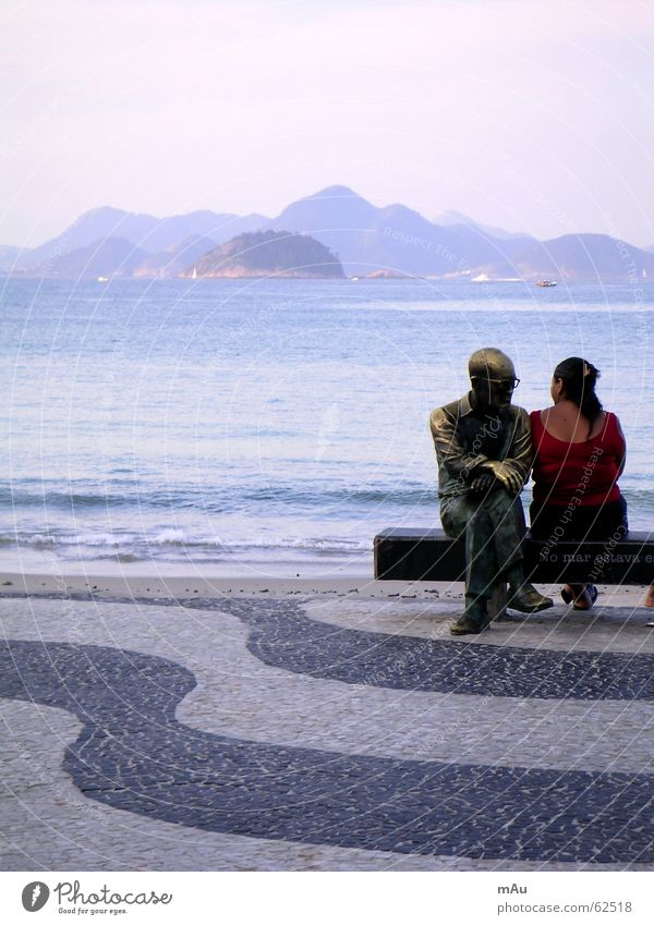 Woman Man White Ocean Black Far-off places Mountain Waves Back Closed Bench Statue Monument Cobblestones Flat Bolivia