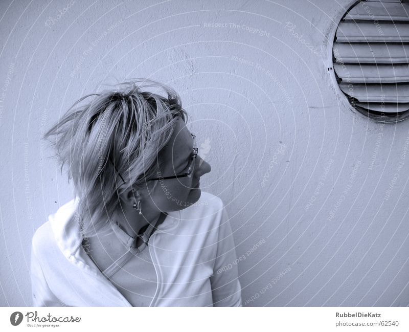 instant Woman Wall (building) Black Eyeglasses Blonde Ventilation Indifference Gale Cold Minimal Backyard Snapshot wise Blue Hue tint Filter Empty Looking