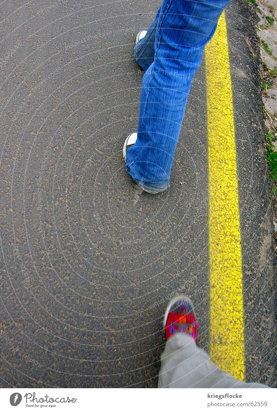 blue-red-yellow Legs Lanes & trails Pants Jeans Footwear Stripe Going Blue Yellow Red Chucks Edge Stride Sidewalk Colour photo Exterior shot Copy Space left