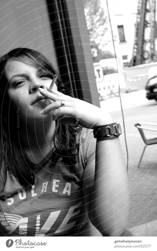 The small tobacco grave Woman Cigarette Café Town Window Beautiful Calm Serene Clock Closing time Looking Smoking Cool (slang) Arm Contentment