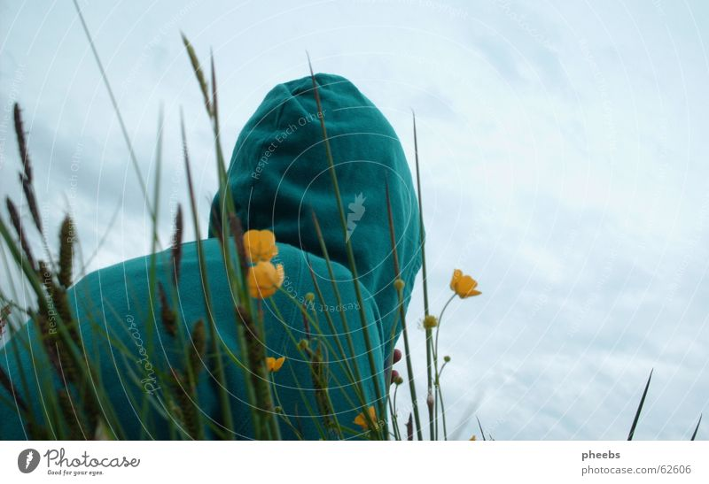 hooded woman Hooded (clothing) Sweater Grass Meadow Flower Green Turquoise Clouds Yellow Summer Spring Lawn Sky Freedom Wrinkles sunshine